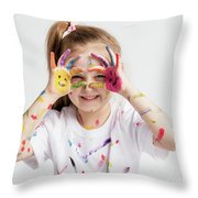 Little Girl Covered In Paint Making Funny Faces. Throw Pillow