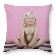Little Girl Sits On A Checkered Floor Throw Pillow