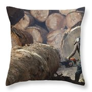 Logger Cutting Tree Trunk, Cameroon Throw Pillow