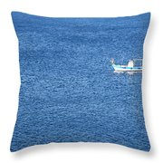 Lonely Fishing Boat Sailing On A Calm Blue Sea Throw Pillow