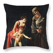 Madonna And Child With A Serpent Throw Pillow by Michelangelo Merisi da Caravaggio