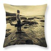 Man Gazing Out On Coastal Rocks Throw Pillow