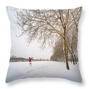 Man In Red Taking Picture Of Snowy Field And Trees Throw Pillow