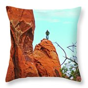 Man On A Rock By Pine Tree Arch Along Devil's Garden Trail In Arches  National Park, Utah Throw Pillow