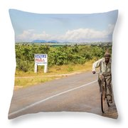 Man On Bicycle In Zambia Throw Pillow