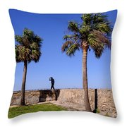 Man With A Hat On The Wall With Palm Trees In Saint Augustine Fl Throw Pillow