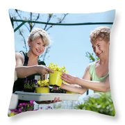 Mature Gardener Helps Senior Client With Flowers Throw Pillow