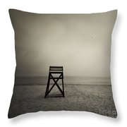 Moody Lifeguard Stand On Beach. Throw Pillow