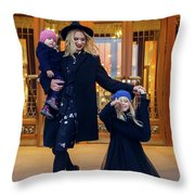 Mother With Two Daughters Standing Next To The Store In The Evening On The Street Throw Pillow