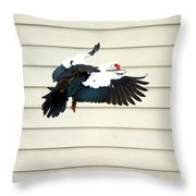 Muscovy Duck In Flight Passing A Building Throw Pillow