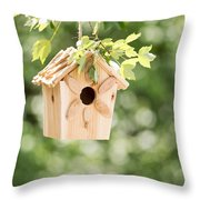 New Wooden Birdhouse Hanging On Tree Branch Outdoors  Throw Pillow