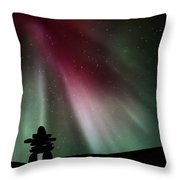 Northern Lights Above An Inukchuk In Saskatchewan Throw Pillow