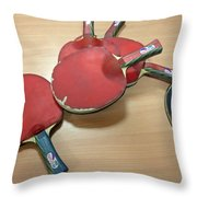Number Of Ping Pong Bats Piled On A Table Throw Pillow