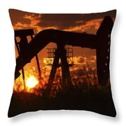 Oil Rig Pump Jack Silhouetted By Setting Sun Throw Pillow