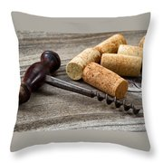 Old Corkscrew With Used Corks In Background On Aged Wood Throw Pillow
