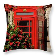 Old Red Telephone Box Or Booth Surrounded By Red Flowers In Toro Throw Pillow