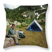 Older Man Resting In Backpacking Camp Throw Pillow