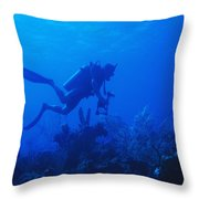 One Man Scuba Diving On Coral Reef Throw Pillow