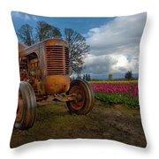 Orange Tractor At Tulip Field Throw Pillow