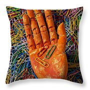 Orange Wooden Hand Holding Paperclips Throw Pillow