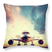Passenger Airplane Taking Off On Runway At Sunset Throw Pillow