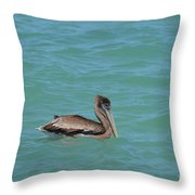 Pelican Floating In The Tropical Waters In Aruba Throw Pillow
