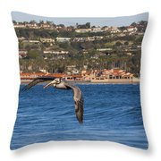 Pelican Flying Above The Pacific Ocean Throw Pillow