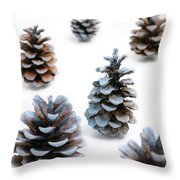Pine Cones Looking Like Christmas Trees On White Snowy Backgroun Throw Pillow