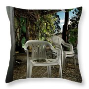 Plastic Chairs Throw Pillow