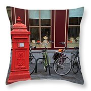 Postbox And Bicycles In Front Of The Diamond Museum In Bruges Throw Pillow
