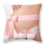 Pregnant Woman Holding Pink Baby Shoes Throw Pillow