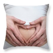 Pregnant Woman With Hands Making Heart Shape On Her Belly Throw Pillow by Oleksiy Maksymenko