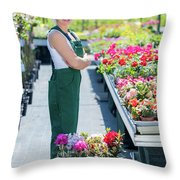 Professional Gardener At Work In A Nursery. Throw Pillow