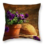 Pruning Purple Pansies Throw Pillow by Sandra Cunningham