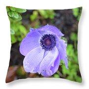 Purple Flowering Anemone Flower In A Lush Green Garden Throw Pillow