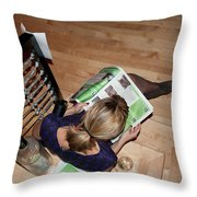 Reading About The Festival Throw Pillow