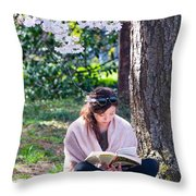 Reading Beneath The Cherry Blossoms Throw Pillow