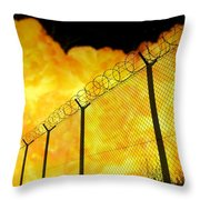 Realistic Orange Fire Explosion Behind Restricted Area Barbed Wire Fence, Blurred Background Throw Pillow