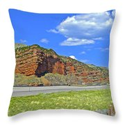 Red Cliffs And White Clouds Over Interstate 80 Rest Stop In Utah  Throw Pillow