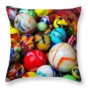 Red Jar Spilling Marbles Throw Pillow