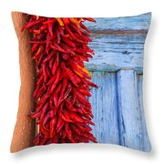 Red Peppers And Blue Door Throw Pillow