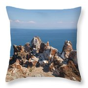 Red Rocks On Blue Sky And Water Background Throw Pillow by Sergey Taran