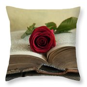 Red Rose On An Old Big Book Throw Pillow