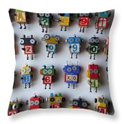 Robots Throw Pillow by Jen Hardwick