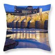 Roman Bridge On Guadalquivir River At Dawn Throw Pillow