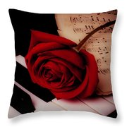 Rose With Sheet Music On Piano Keys Throw Pillow