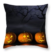 Row Of Halloween Pumpkins In A Spooky Forest At Night Throw Pillow