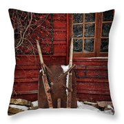 Rusty Wheelbarrow Leaning Against Barn In Winter Throw Pillow by Sandra Cunningham