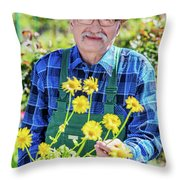 Senior Gardener Showing A Potted Flower. Throw Pillow