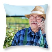 Senior Gardener Talking On The Phone With A Client. Throw Pillow